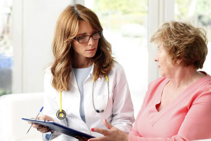 Doctor and Alzheimers disease patient